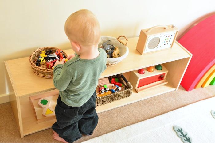 Montessori toddler bedroom Otto in reading corner at How we Montessori 17 months