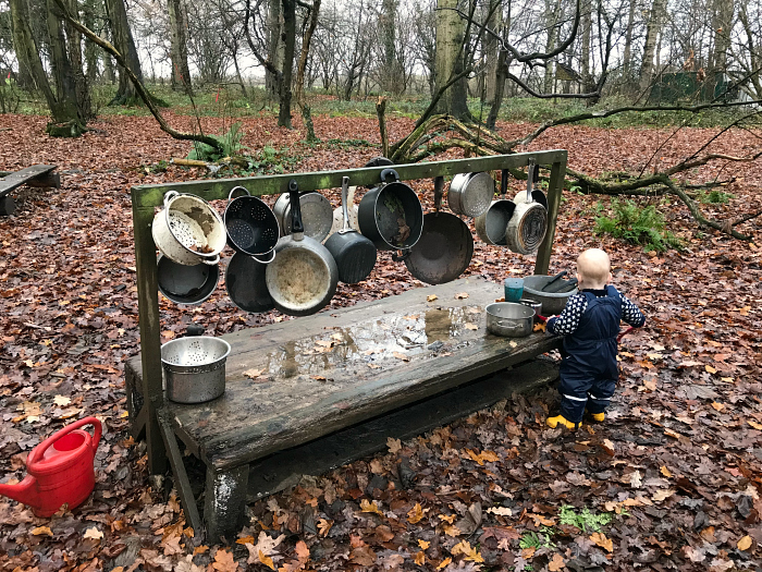 Otto at outdoor xylophone at Forest School  14 months at How we Montessori