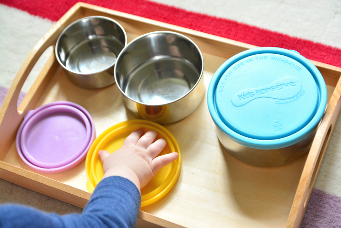Glass jars with lids for matching at How we Montessori