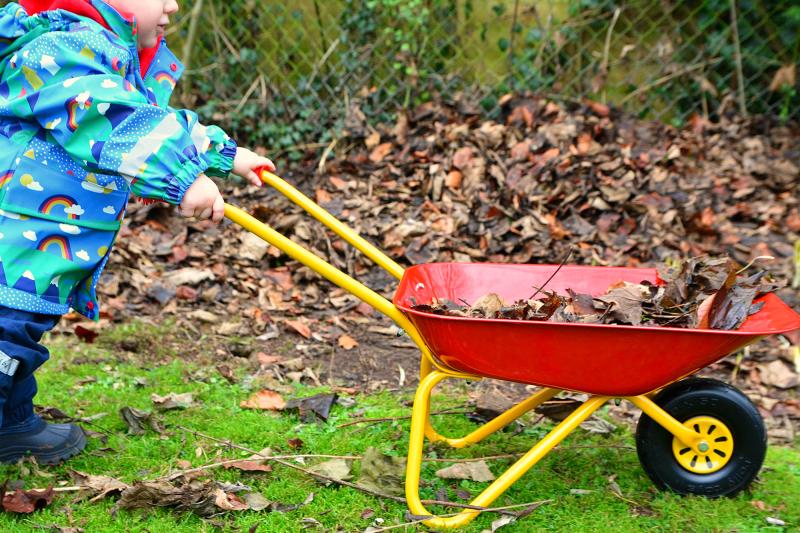 Otto using wheelbarrow at 15 months at how we Montessori