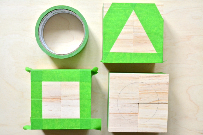 Painters tape on DIY cube puzzle at How we Montessori 2019 toddler shape puzzle