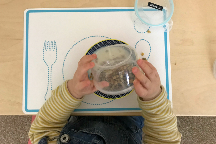Otto eating hommus out of small jar toddler portions at how we montessori