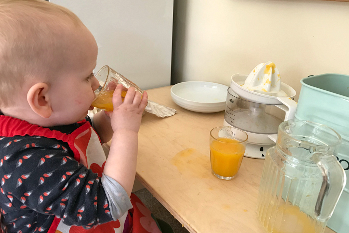 Otto pouring juice at 18 months at How we Montessori
