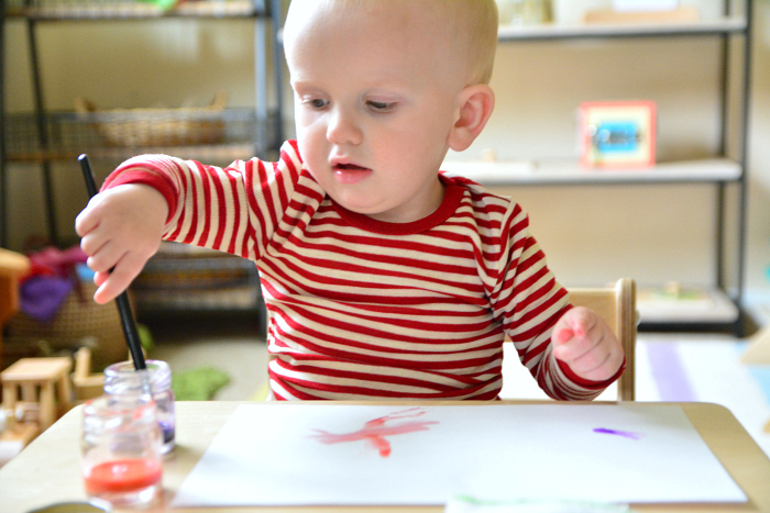 Otto  water colour painting at 18 months at How we Montessori