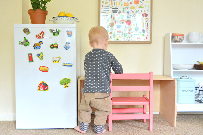 Otto using toddler fridge at How we Montessori 2019
