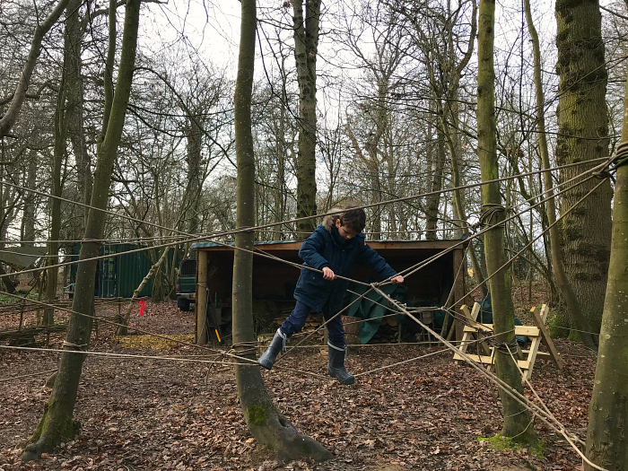 Otis at Forest School March 2019 at 7 years at How we Montessori  rope climbing
