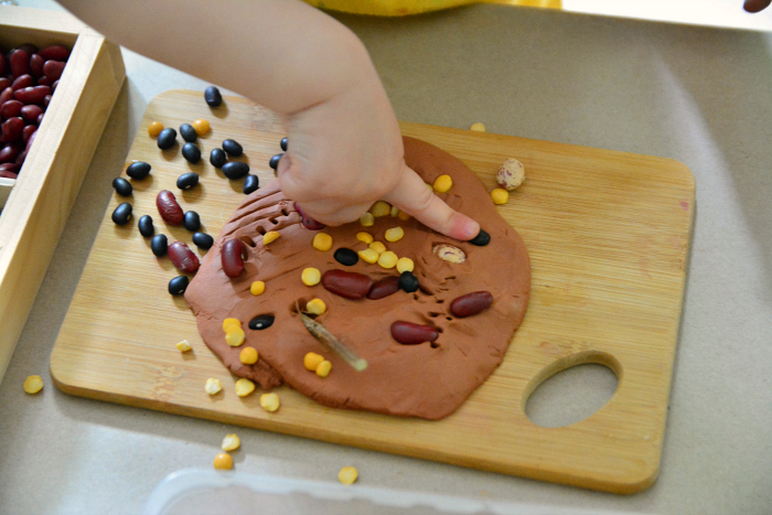 Otto fine motor work  using clay at 21 months  Montessori toddler