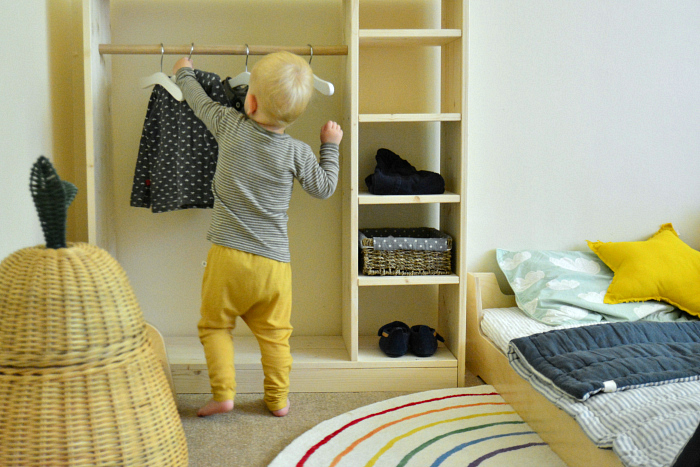 Otto reaching montessori wardrobe at how we montessori