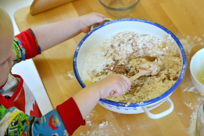 Montessori toddler kitchen skills  Otto 22 months  peeling a banana at How we Montessori