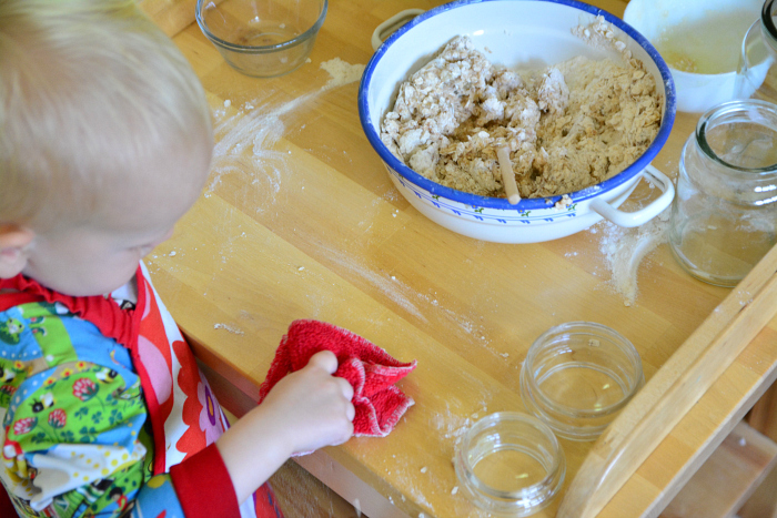 Montessori toddler kitchen skills  Otto 22 months  peeling a banana at How we Montessori