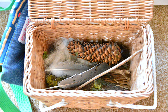 Toddler entry way nature basket at How we Montessori