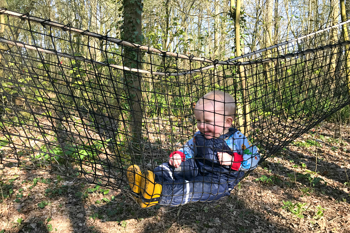 Otto in net at forest school 2019 at How we Montessori
