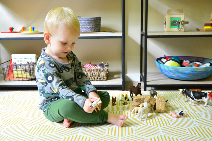 Otto playing on play mat at How we Montessori