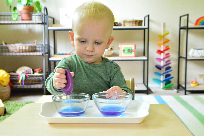Montessori toddler using baster at How we Montessori