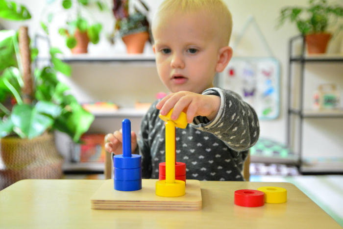 Otto 21 months  first colour sorting at How we Montessori  coloured dowels toddler threading activity