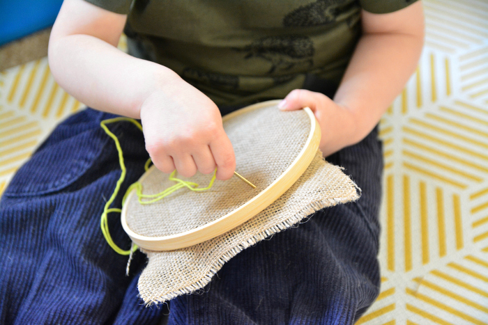 First sewing tray at How we Montessori  Otto 25 months  embroidery freestyle