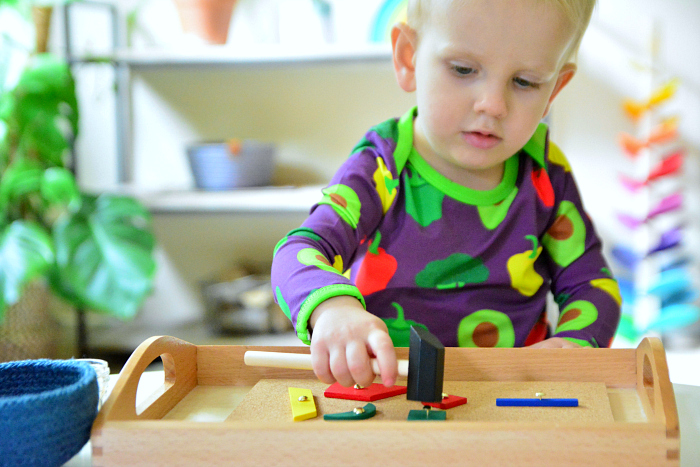 Montessori toddler tap tap toy hammer and nails at How we Montessori