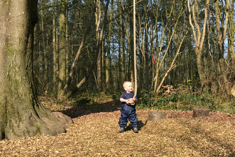 Otto with tree swing at How we Montessori  forest school uk