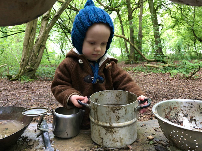 Mud kitchen play at Forest School at How we Montessori