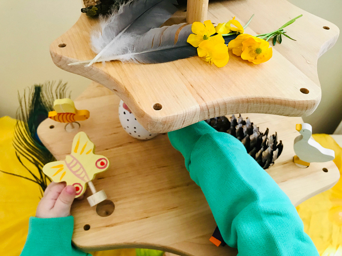 Yellow spring nature table at How we Montessori