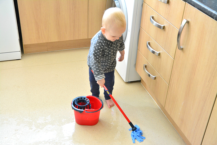 Otto cleaning floor with sniffer  Montessori toddler cleaning floor at How we Montessori