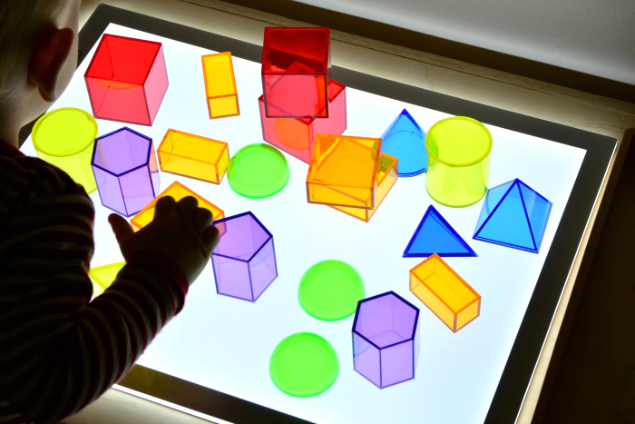 Toddler Light Table at How we Montessori geometric shapes 20 months