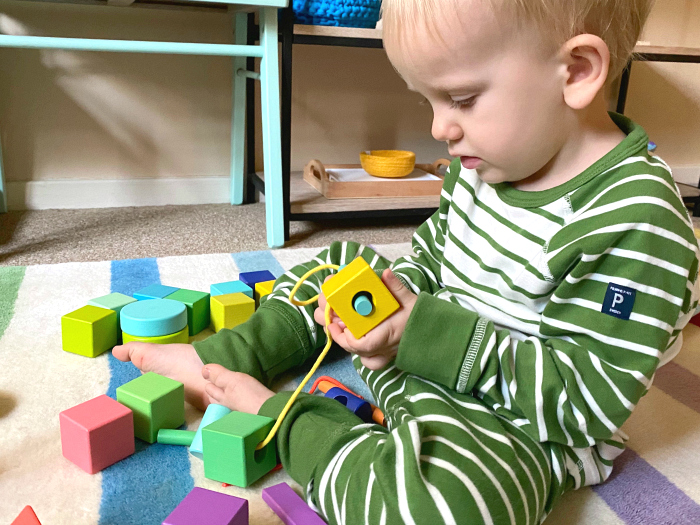 Otto 27 months threading blocks by Lovevery at how we Montessori toddler blocks