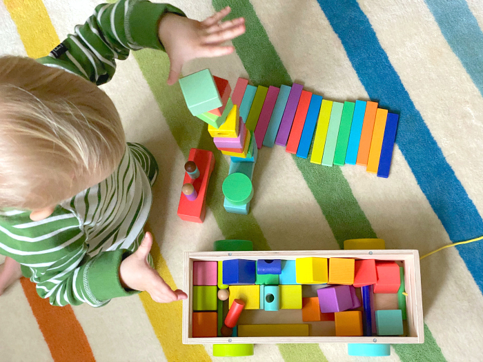 Otto using Lovevery blocks at How we Montessori 27 months most used Christmas toy