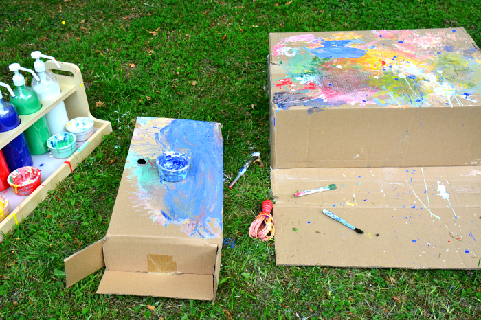Otis and Otto's creative painting on boxes at How we Montessori