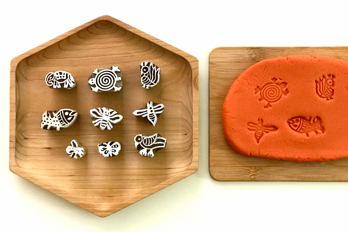 Block stamps on pumpkin spice play dough at How we Montessori