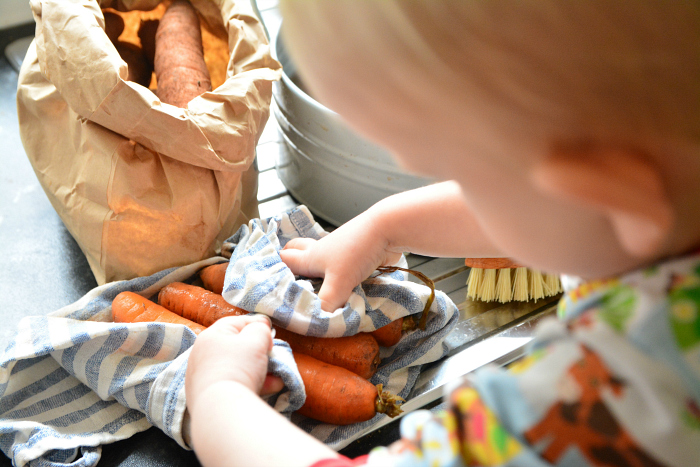 How we Montessori practical life  toddler washed carrots
