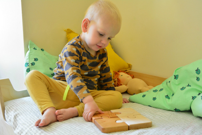 Otto 21 months with first jigsaw by Heirloom kids at How we Montessori