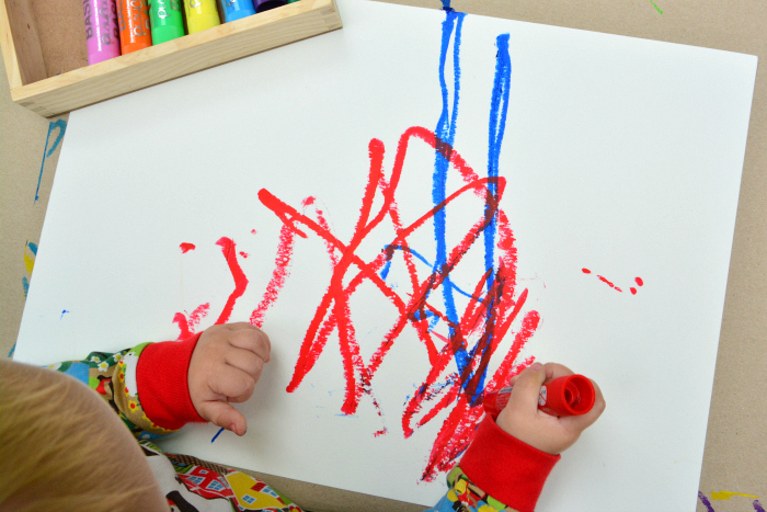 Montessori Toddler Art Paint sticks  Otto 22 months at How we Montessori