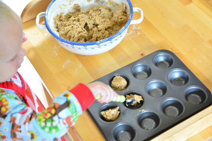 Montessori toddler baking muffins  Otto getting out cool muffins at 22 months