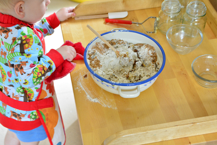 Baking with a Montessori toddler  otto at 22 months pouring coconut sugar at How we Montessori