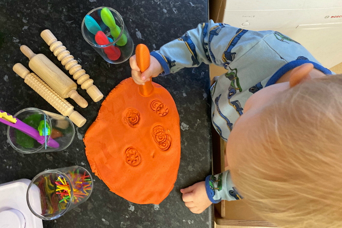 Toddler flower arranging at how we montessori 25 months