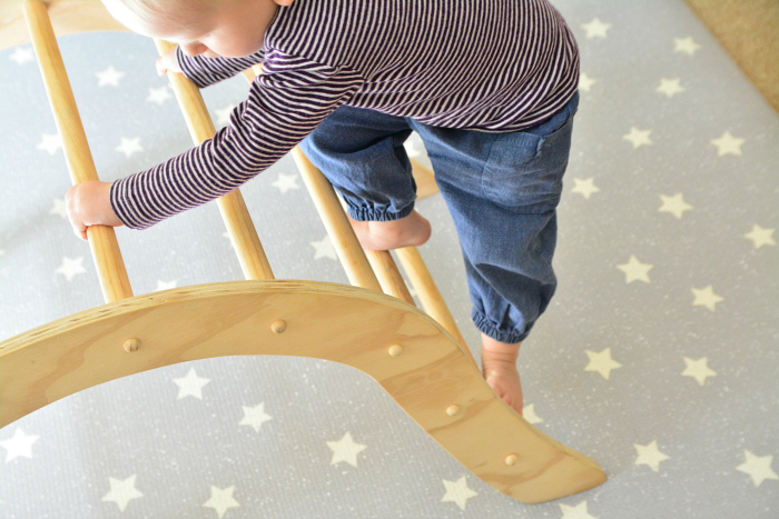 Montessori toddler play mat and piker arch at How we Montessori