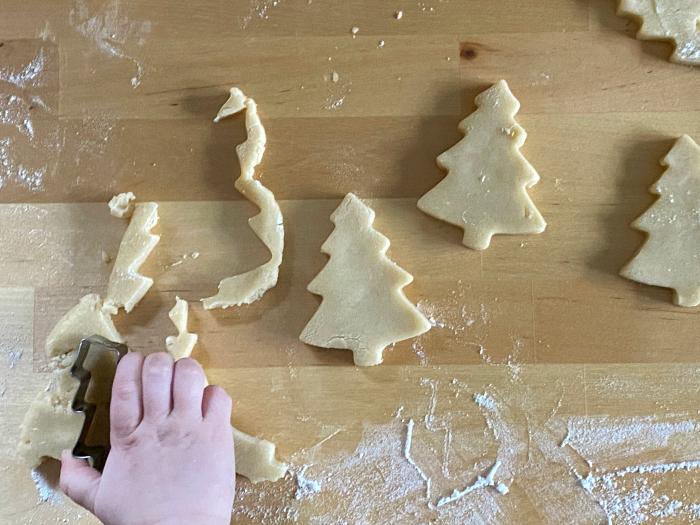Otto making Christmas tree sugar cookies at How we Montessori
