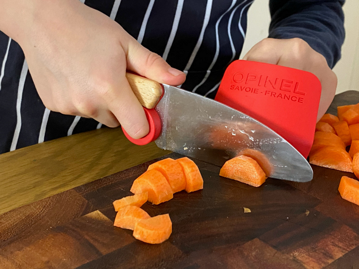 Children's kitchen and chef knife reviews opinel including finger guard at How we Montessori Otis 8 years