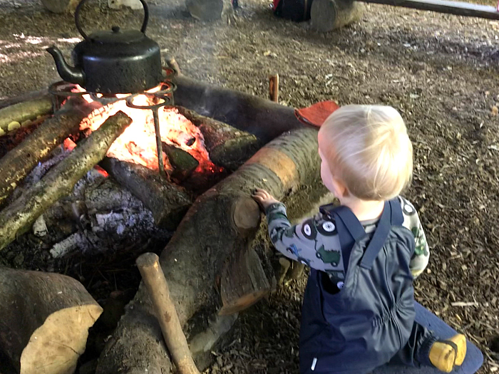 Forest School  Toddler learning about fire  camp fire at How we Montessori