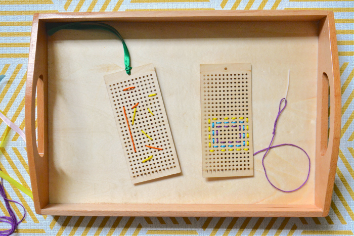 Handmade gifts cross-stitch bookmarks at How we Montessori toddler at 25 months  eight year old