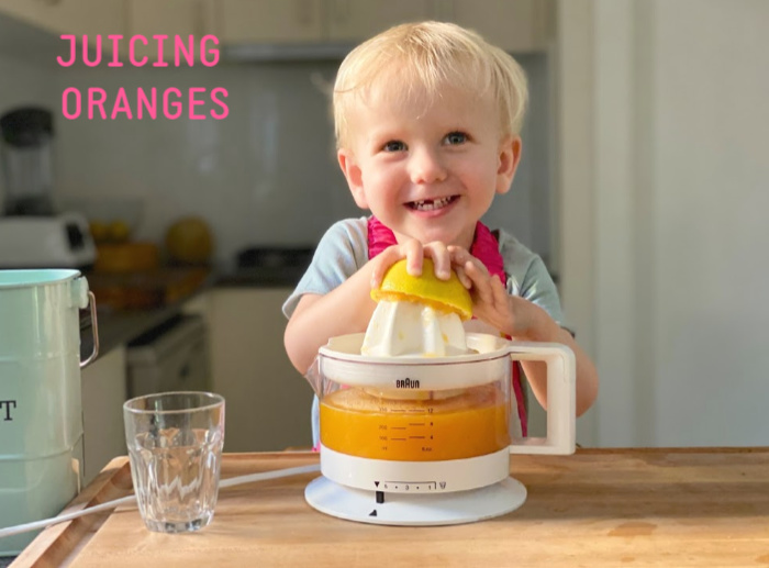How we Montessori toddler juicing orange 2 years old (4)