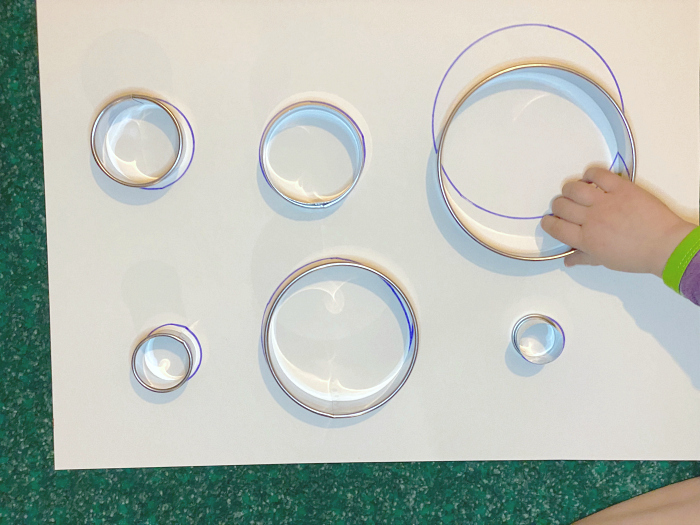 How we Montessori matching work for toddlers using cookie cutters for Otto
