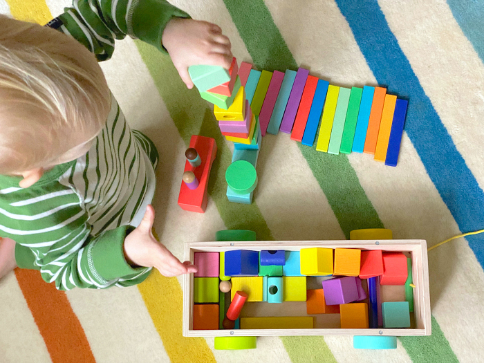 Lovevery Blocks at How we Montessori  Otto building tower with block cart at 27 months