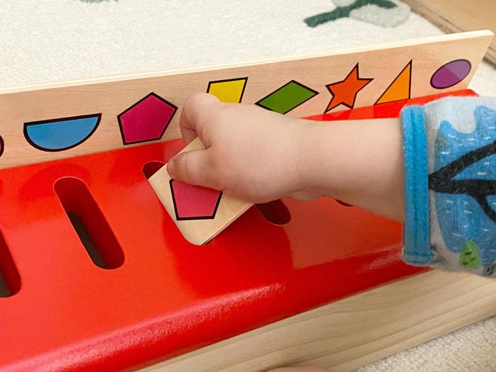 Montessori toddler sorting box at How we Montessori transportation box Otto 27 months