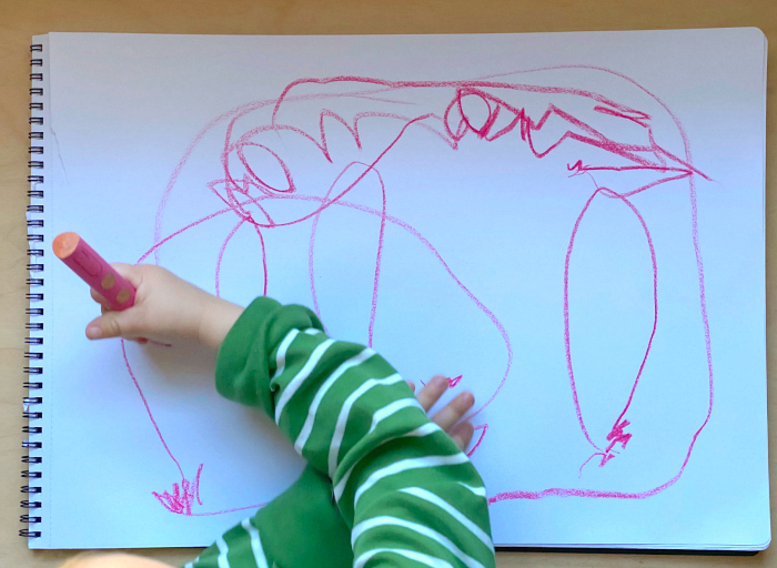 Otto's first circles drawing at 31 months  two years old at How we Montessori  crossing the midline