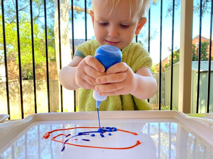 Increasing toddler hand strength at How we Montessori