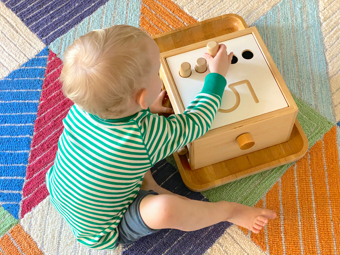 Montessori toddler tumble down counting pegs at how we montessori maths toy toddler