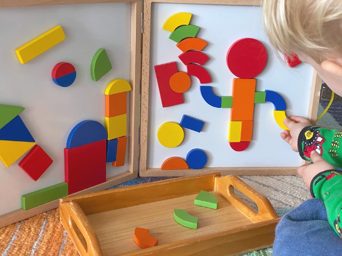 Montessori toddler learning about shapes using magnetic shape builder