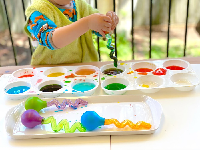 Colour mixing using a twisty dropper at How we Montessori Otto at 2 years